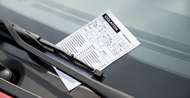 Traffic ticket placed on a car windshield