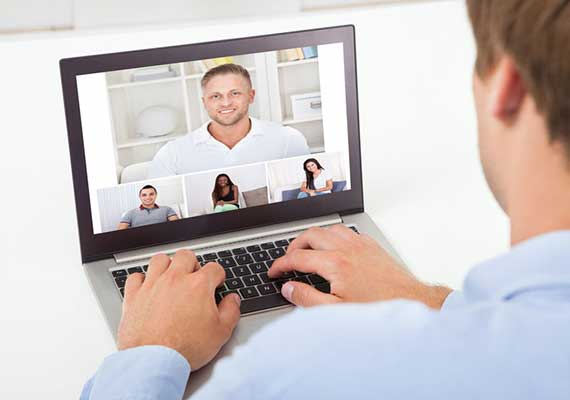Image of a web conference on a laptop