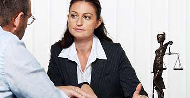 Woman attorney discussing with male
