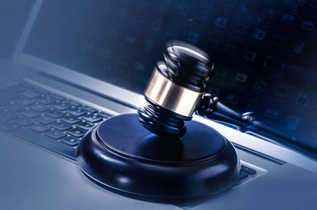 Gavel on laptop