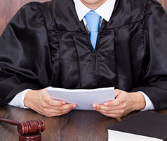 Judge holding papers on bench