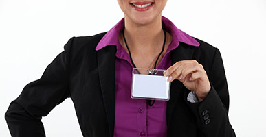 Woman holding a visitor badge