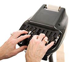 person typing on a shorthand machine