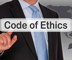 Man pointing at words Code of Ethics