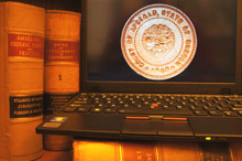 Computer with Court of Appeals seal; books in background